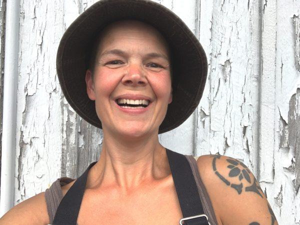 Sara smiling, wearing a hat
