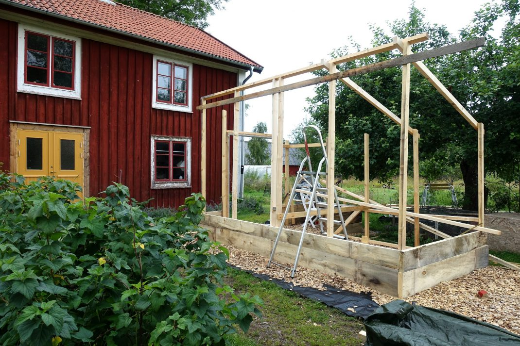 Build a greenhouse, in front of a house.