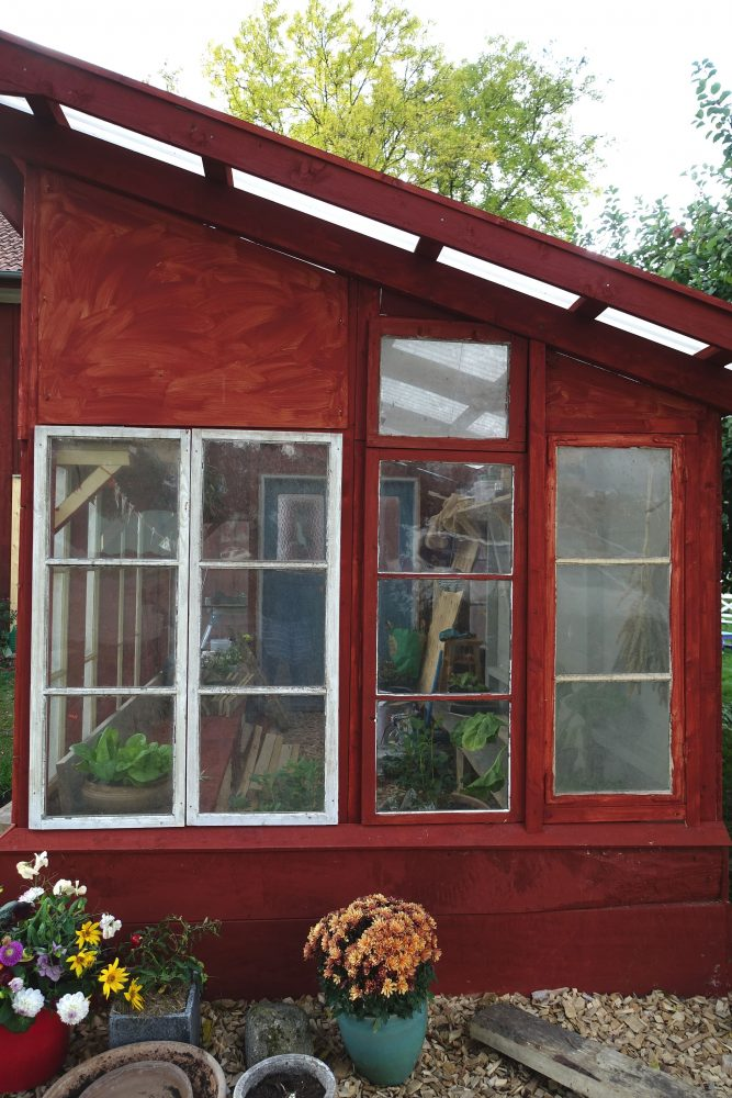 Glass window on the gable of the greenhouse.